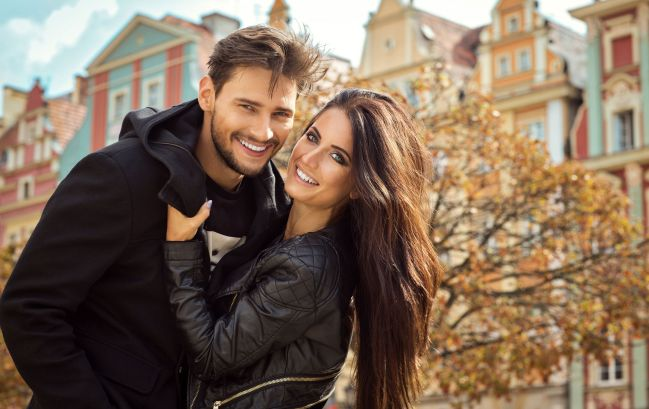 46809485 - beautiful happy couple in autumn scenery